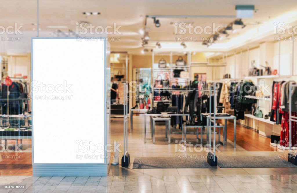 Clothes shop entrance with empty billboard mockup Clothes shop entrance with empty billboard mockup to place text, logo or advertisement Advertisement Stock Photo