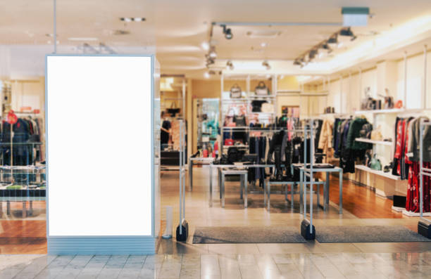 clothes shop entrance with empty billboard mockup - shopping mall stock photos and pictures