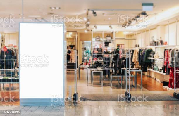 Clothes Shop Entrance With Empty Billboard Mockup Stock Photo - Download Image Now
