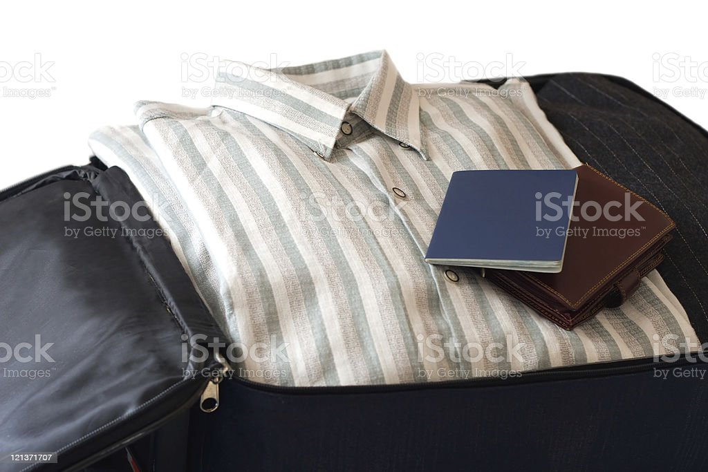 clothes, wallet and passport in suitcase (isolatedon white backg royalty-free stock photo