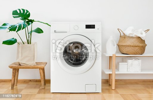 istock Clothes washing machine in laundry room interior 1152782419
