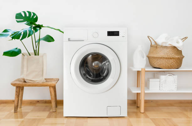 Clothes washing machine in laundry room interior stock photo