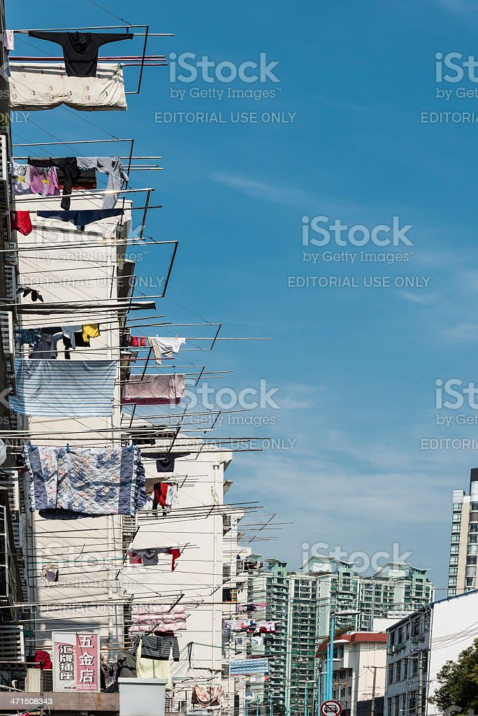 clothesline on building of shanghai china royalty-free stock photo