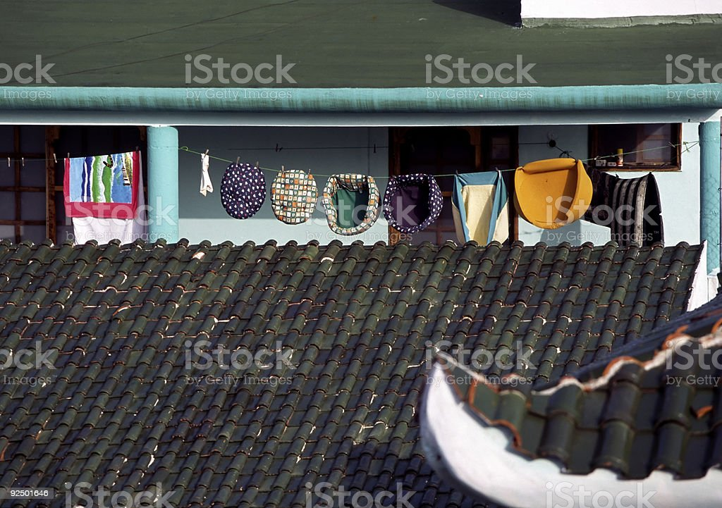 Clothesline over a green tile roof royalty-free stock photo