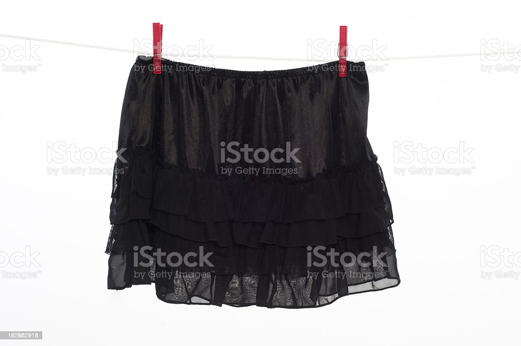 Clothesline with black skirt stock photo