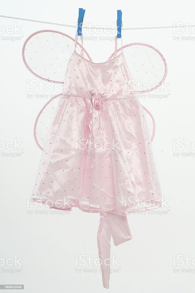 Clothesline with fairy dress stock photo
