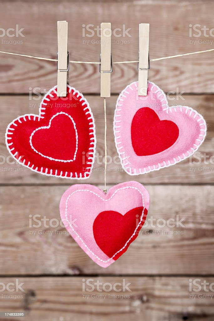 Clothesline with Valentine's Day hearts decorations on a rustic background royalty-free stock photo