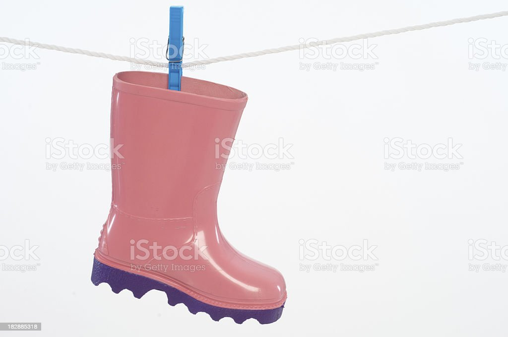 Clothesline with water boots stock photo