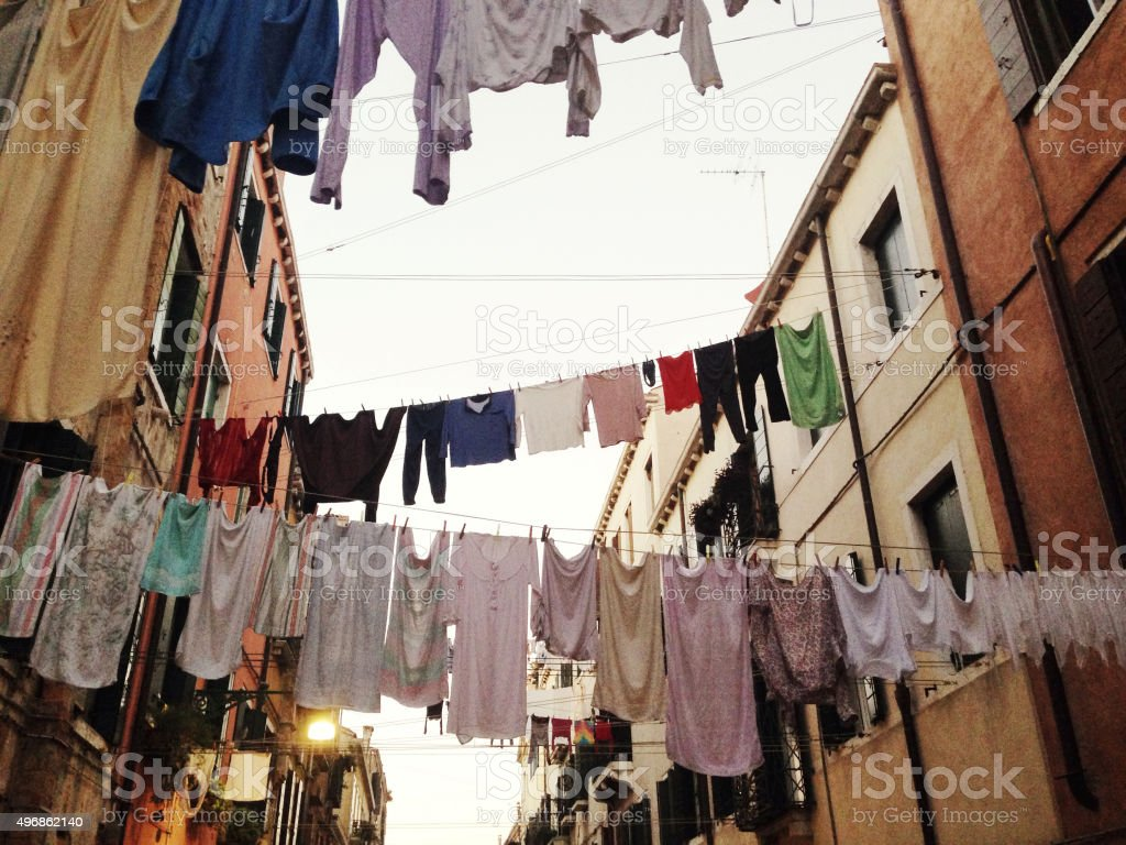Clotheslines hanging from apartments stock photo