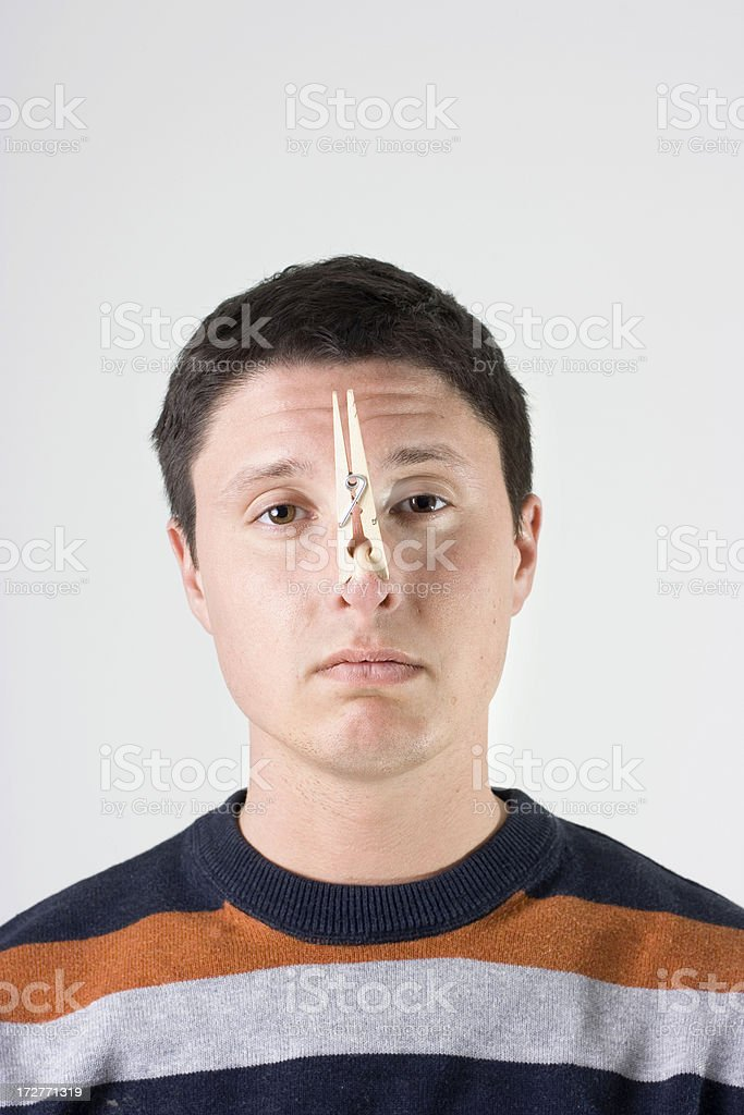 Clothespin on the nose royalty-free stock photo