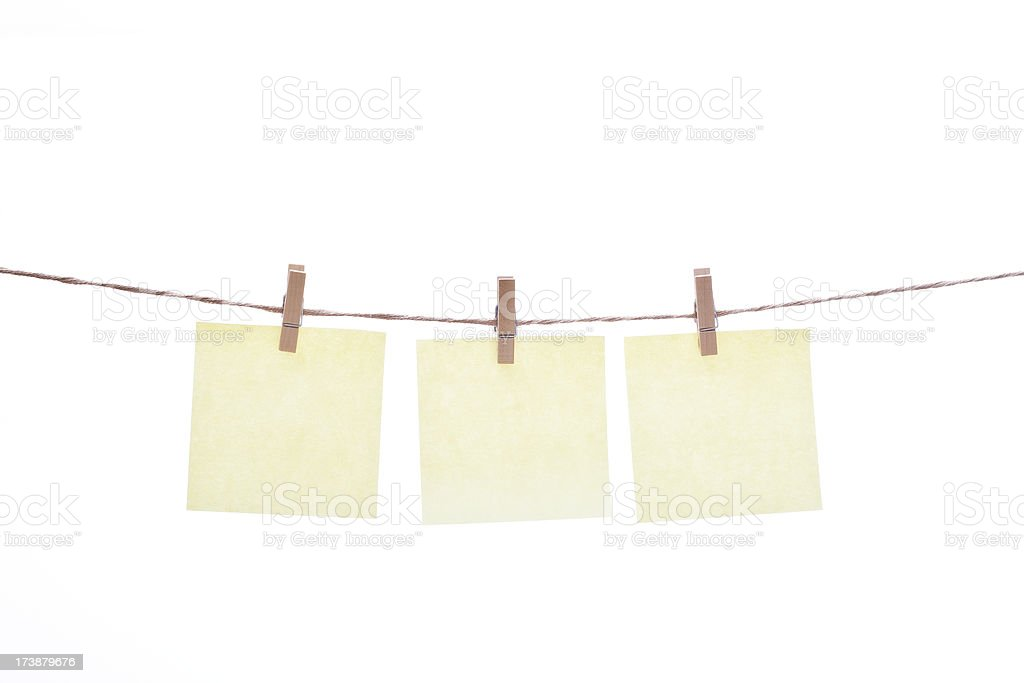 Clothespins and yellow notes royalty-free stock photo