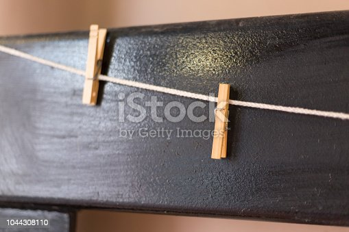 istock Clothespins wall background 1044308110