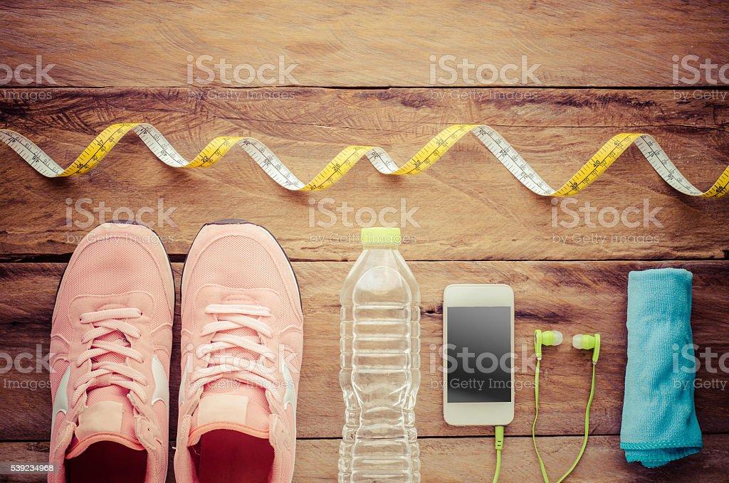Clothing accessories for the fitness of women on wood floor foto de stock libre de derechos