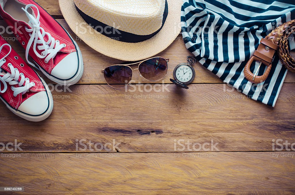 Clothing and accessories for womens on wood floor royalty-free stock photo