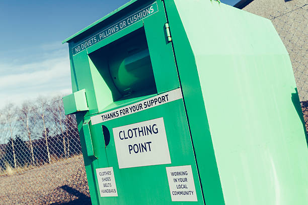 clothing bank - bin stock pictures, royalty-free photos & images