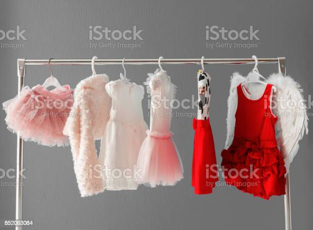 Clothing for a little girl on a clothes rack in a wardrobe picture id852063084?b=1&k=6&m=852063084&s=612x612&h=xm4o0nqu 0dmy2wxnesxzufz7i5xgvhqs078mlv9jxq=