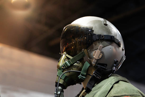 clothing for pilots or Fighter pilot suit on black background clothing for pilots or Fighter pilot suit on black background flight suit stock pictures, royalty-free photos & images