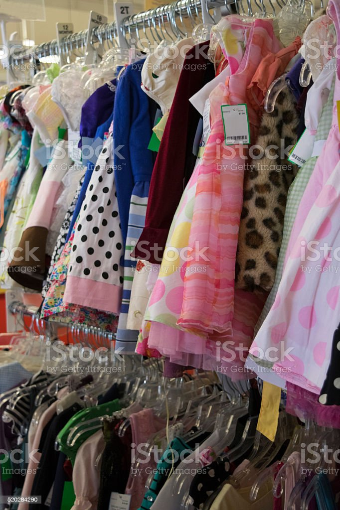Clothing hanging on a rack in a store stock photo