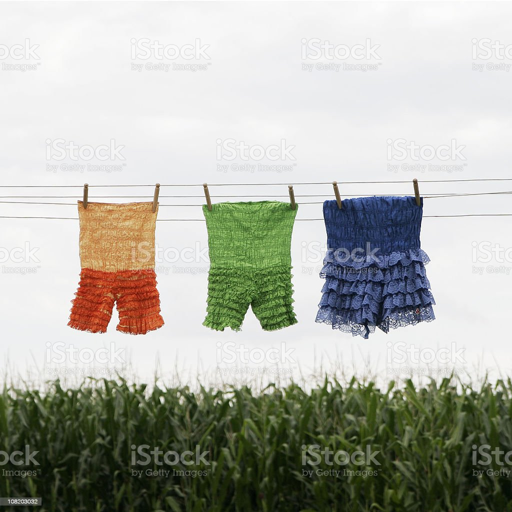 Clothing Hanging on Clothesline Drying- Ruffled Vintage Bloomers stock photo