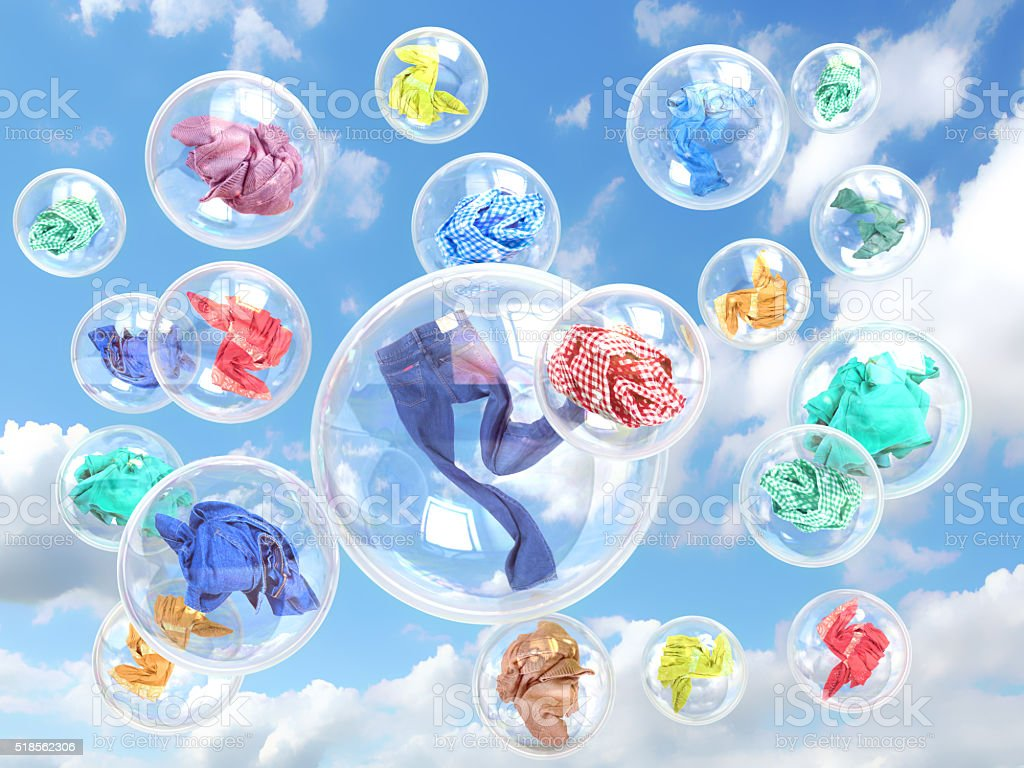 clothing in soap bubbles on sky background concept of washing stock photo