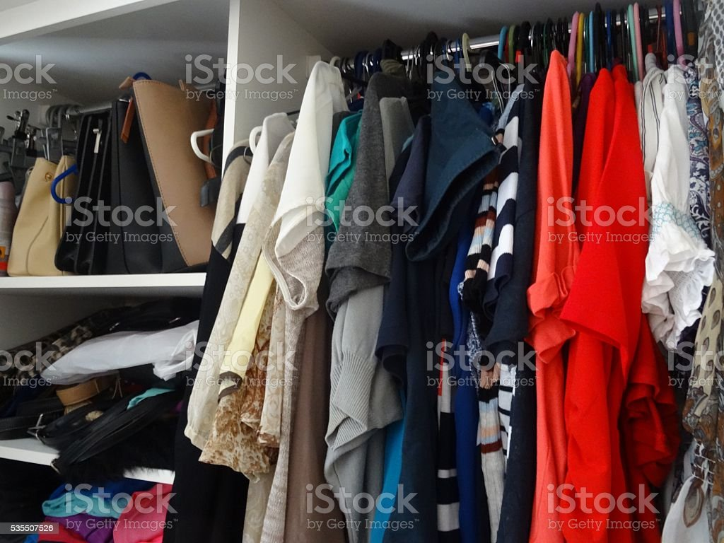 Clothing in wardrobe stock photo