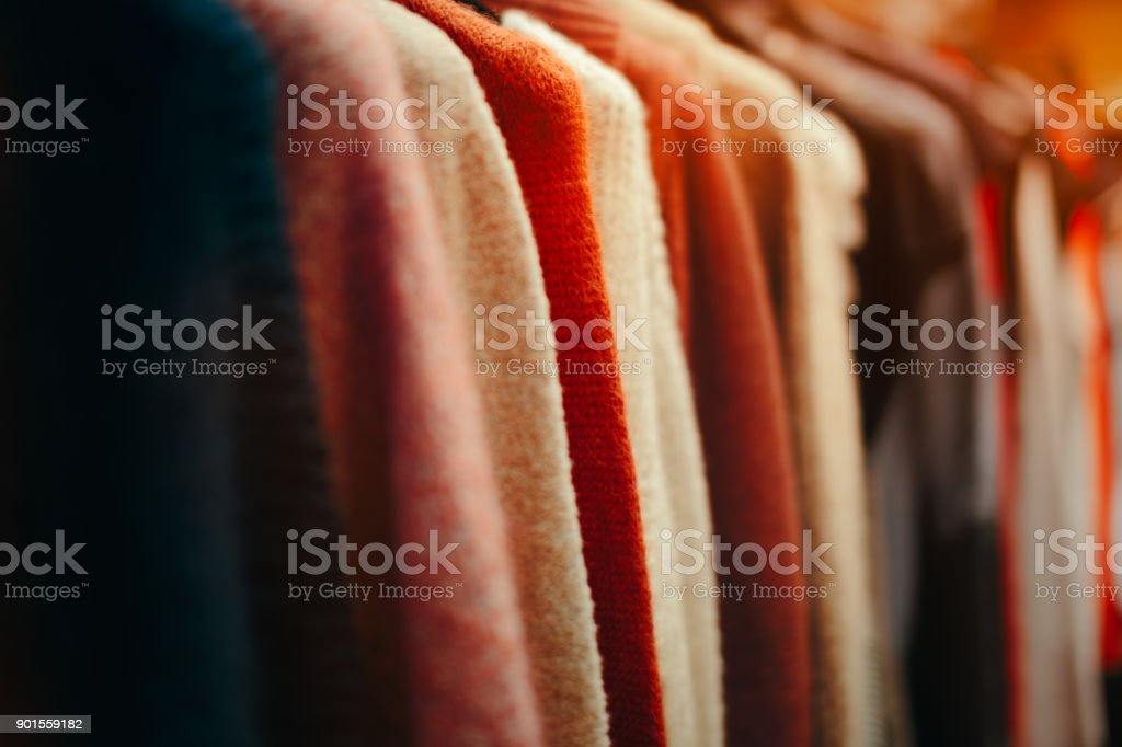 Clothing Items on a Rack in Fashion Store stock photo