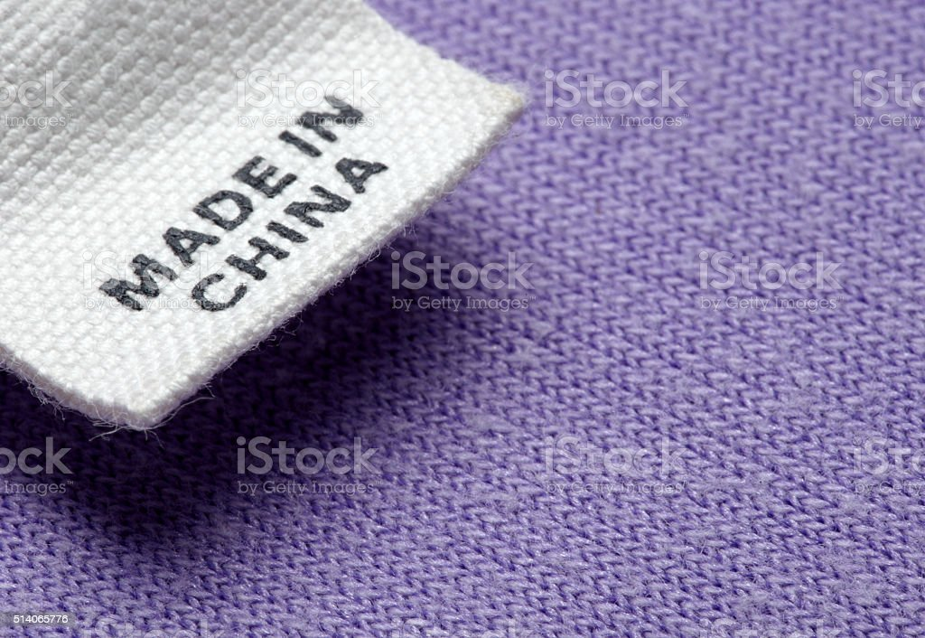 clothing label made in china cheap stock photo
