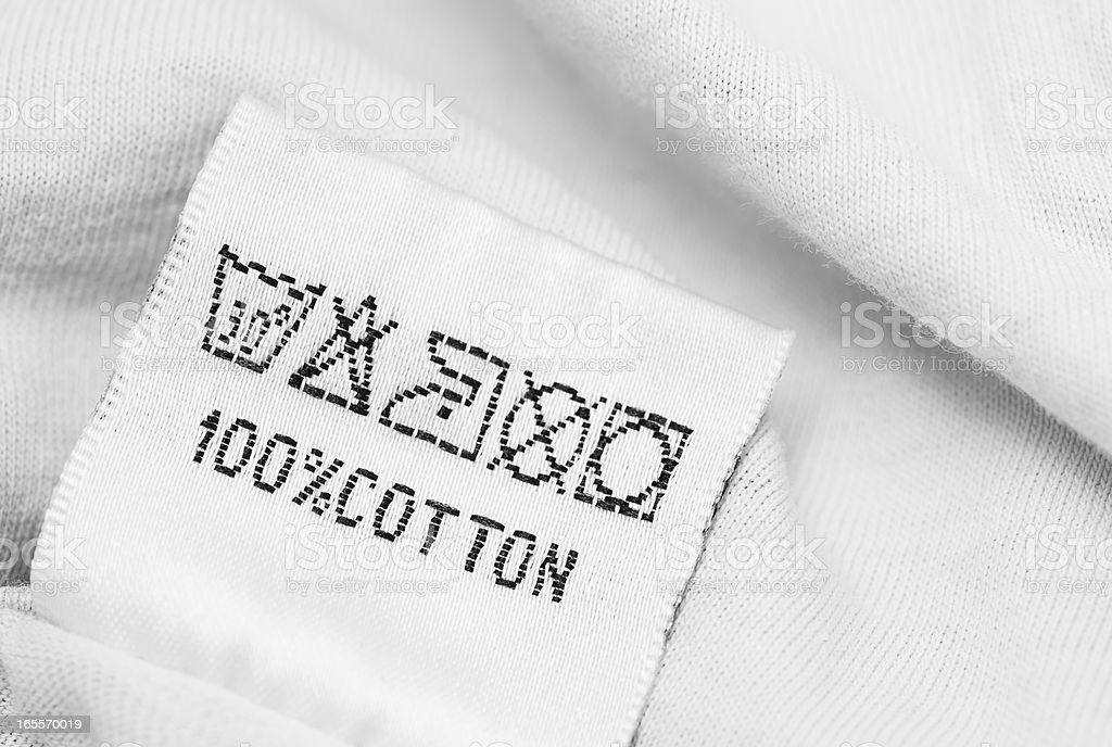 Clothing label with  laundry care instructions stock photo