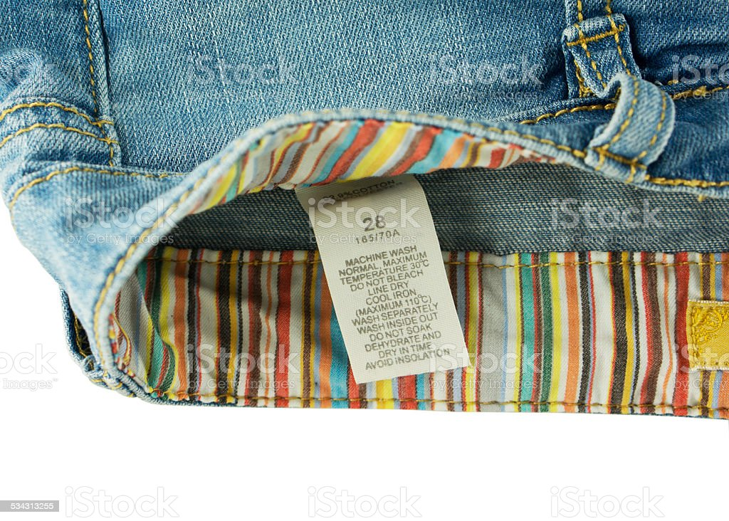 Clothing label with laundry care on jeans stock photo