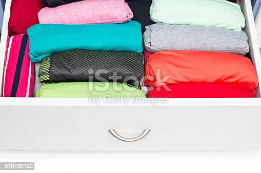 1222867278 istock photo Clothing lying in the drawer in the wardrobe 619498162
