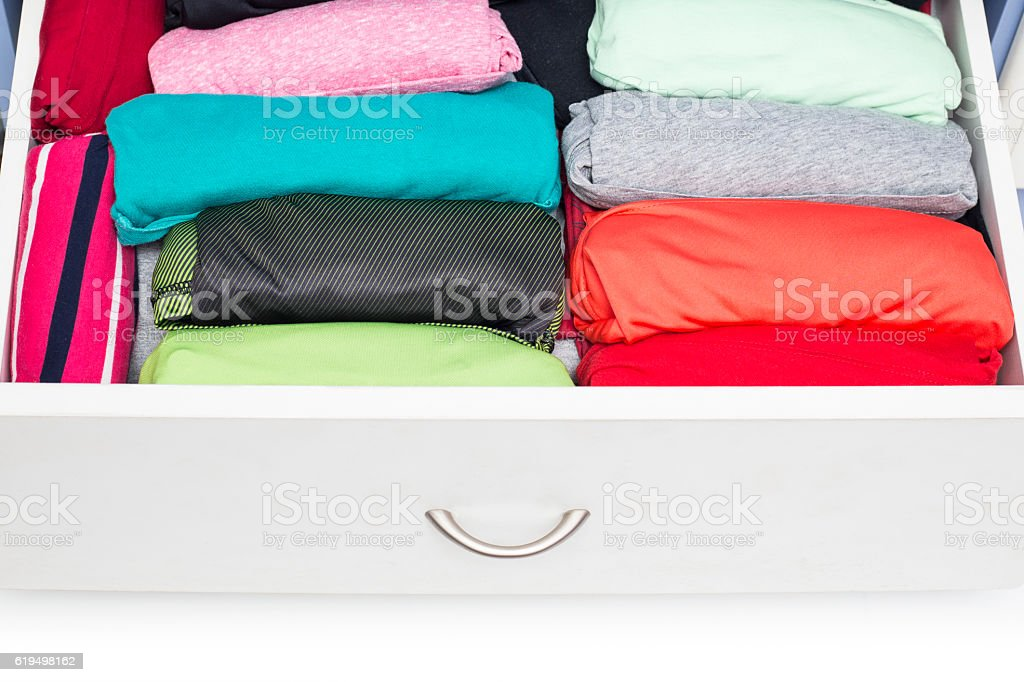 Clothing lying in the drawer in the wardrobe stock photo