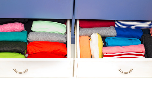 istock Clothing lying in the drawer in the wardrobe. 623607982