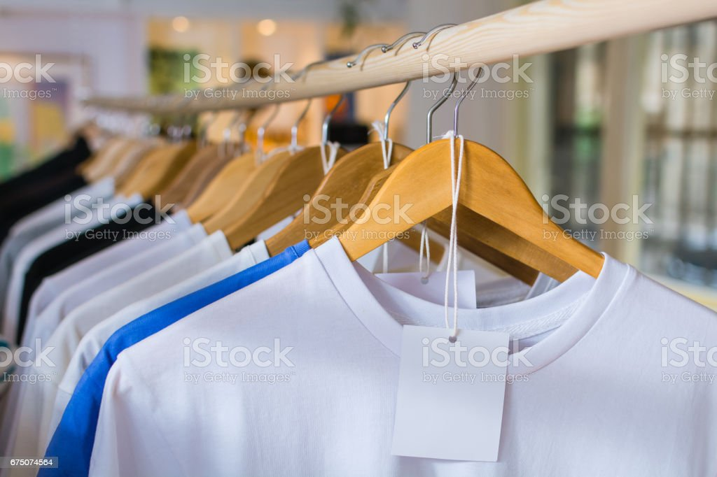 Clothing on a hangers at the shop boutique stock photo