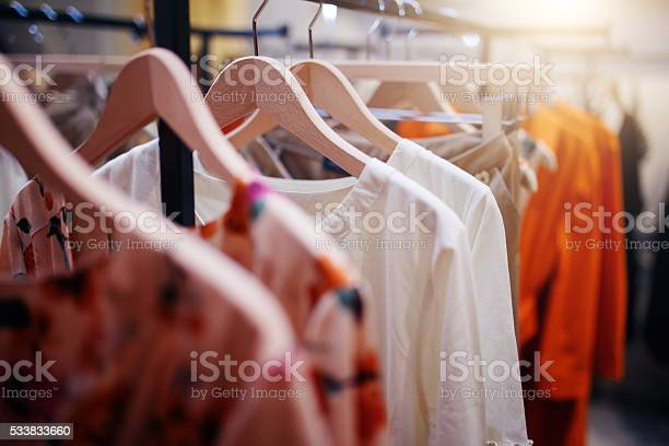 Clothing on hanger at the modern shop boutique