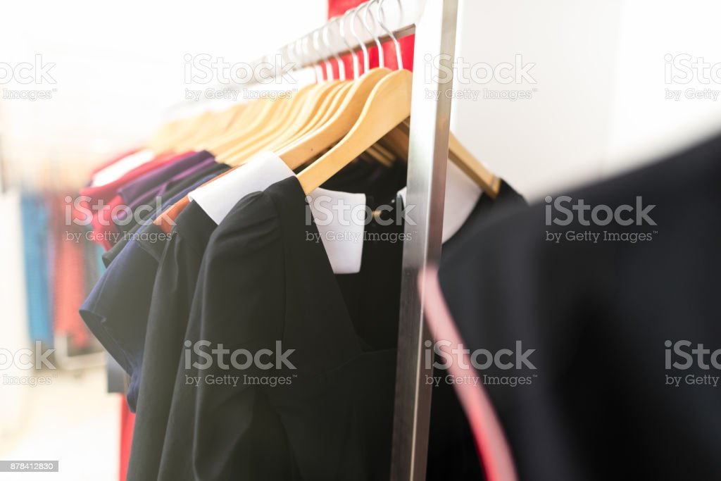 Clothing on hanger at the trendy shop boutique stock photo