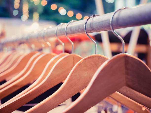 Clothing on Hangers Fashion retail Display Shop Outdoor Market event Clothing on Hangers Fashion retail Display Shop Outdoor Market event Festival coathanger stock pictures, royalty-free photos & images