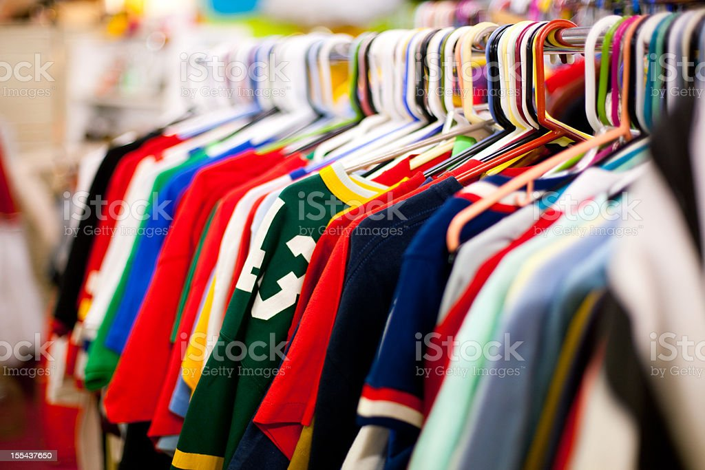Clothing Rack full of T-Shirts at a Thrift Store stock photo
