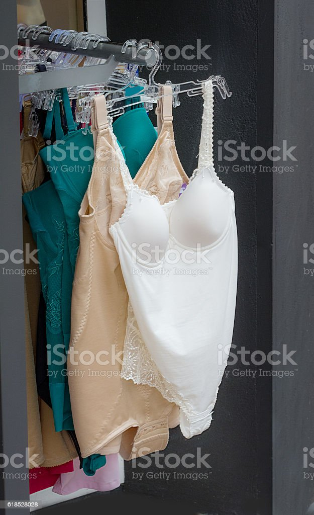 Clothing rack with underwired  bodysuits on a clothes rack outside - foto de stock