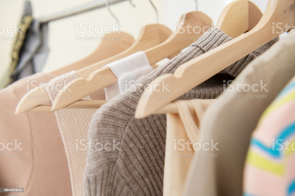 Clothing rack with woman cloth hanging on it. - Royalty-free Adult Stock Photo