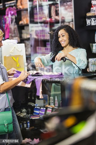 istock Clothing store cashier scanning price tag at checkout 470310194