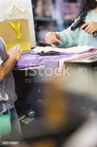 istock Clothing store cashier scanning price tag at checkout 533740901