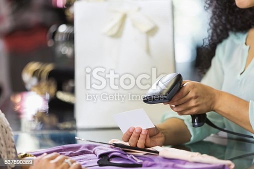 istock Clothing store cashier scanning price tag at checkout 537890389