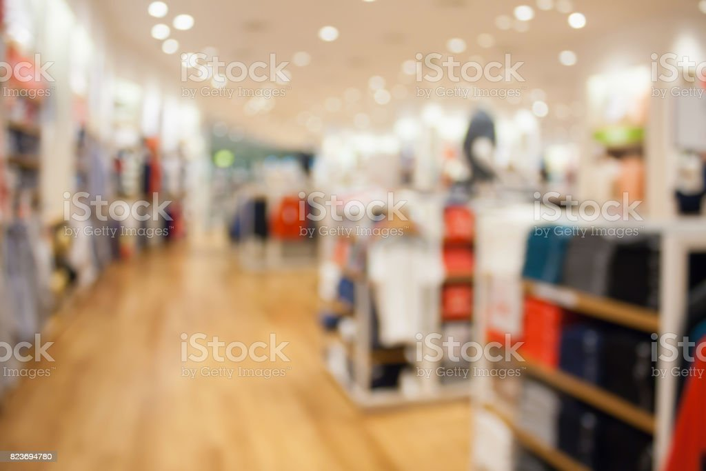 clothing store interior blurred background stock photo