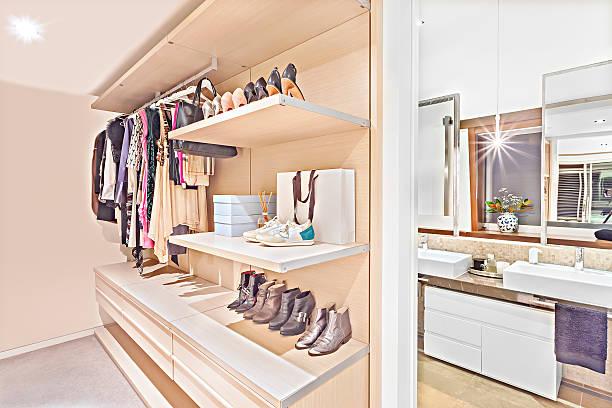 clothing store of a house or hotel with attached bathroom - garderobe mit schuhschrank stock-fotos und bilder