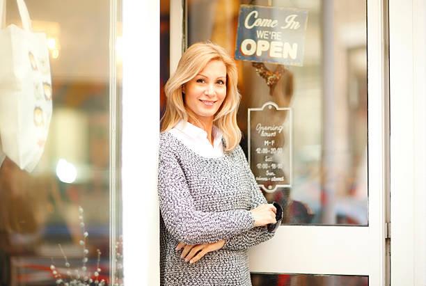 Cтоковое фото Деловая женщина Одежда магазин владелец