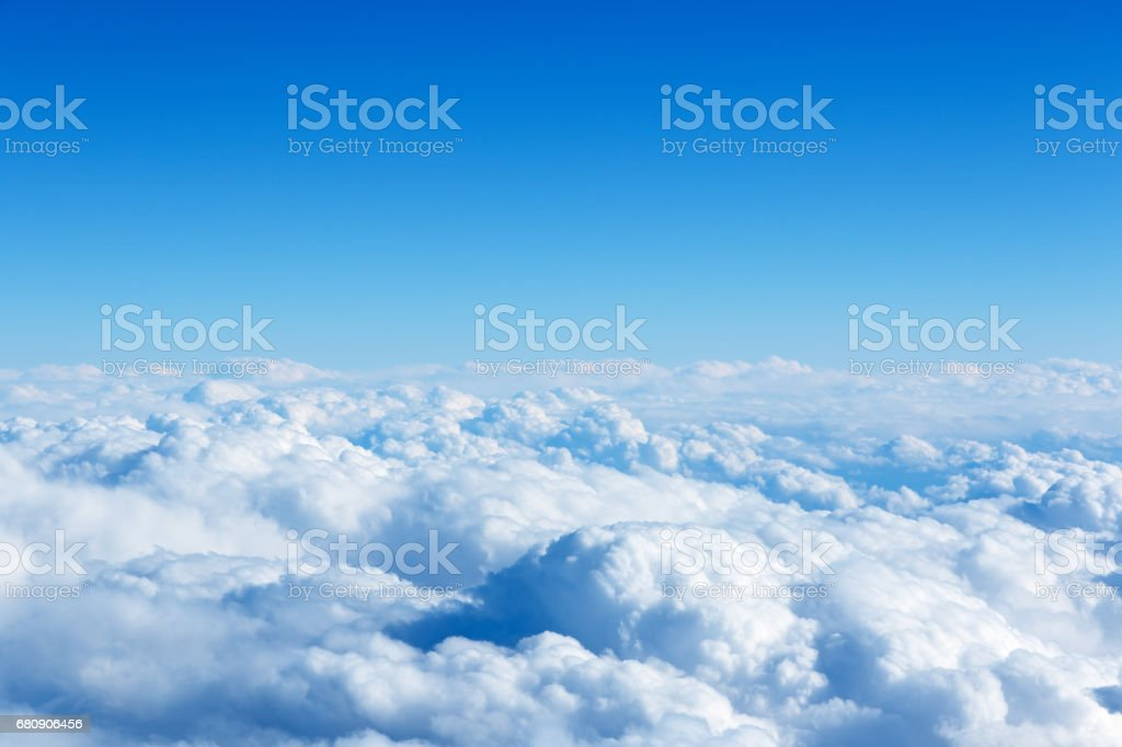 Cloud and blue sky from the airplane windows stock photo