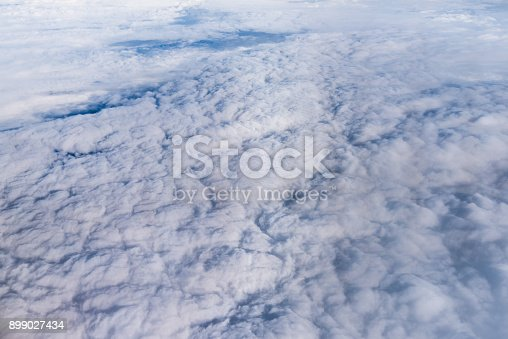 istock cloud and blue sky view from window of airplane 899027434