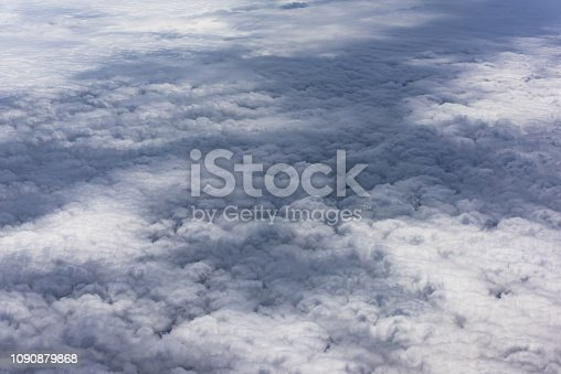 istock cloud and sky view from window of airplane 1090879868