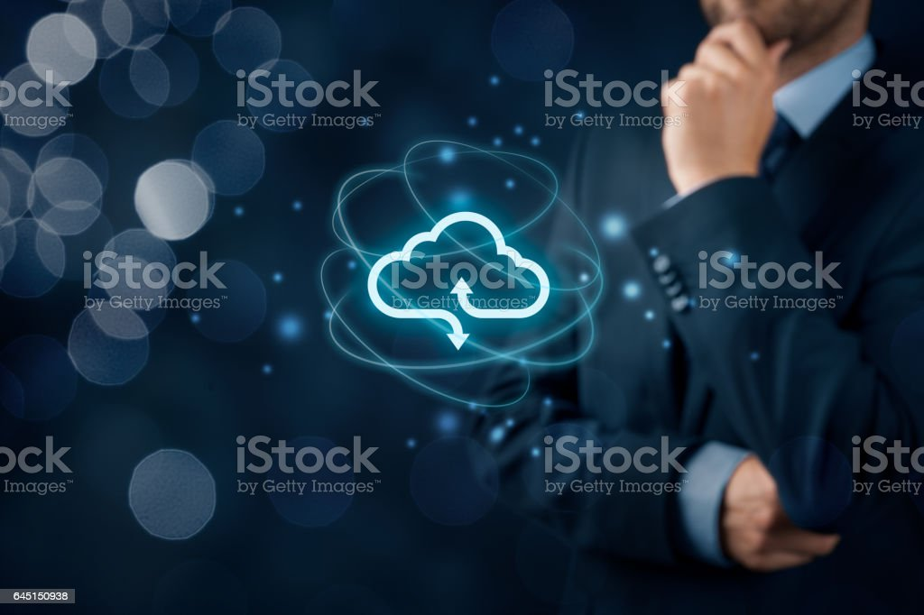 Cloud computing concept Cloud computing concept - connect to cloud. Businessman or information technologist with cloud computing icon. Adult Stock Photo