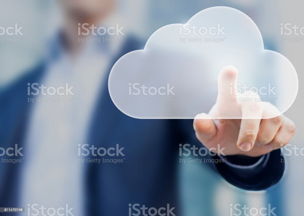 Cloud computing concept with a person touching a virtual digital icon stock photo